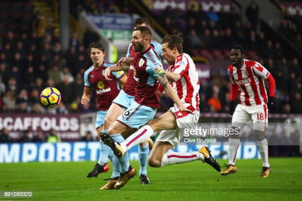 Peter Crouch of Stoke City challenges for the ball with Phil Bardsley of Burnley during the Premier League match between Burnley and Stoke City at...