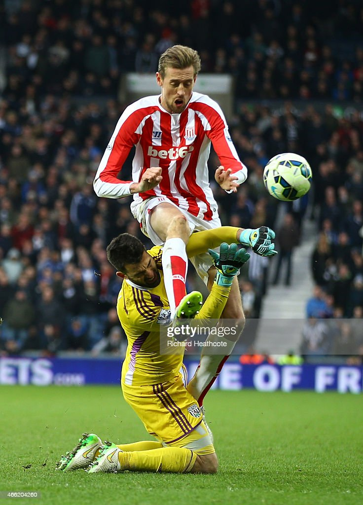 Peter Crouch of Stoke City clashes with goalkeeper Boaz Myhill of West Brom during the Barclays Premier League match between West Bromwich Albion and Stoke City at The Hawthorns on March 14, 2015 in West Bromwich, England.
