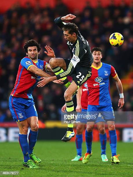 Peter Crouch of Stoke City clashes with Mile Jedinak of Crystal Palace during the Barclays Premier League match between Crystal Palace and Stoke City...