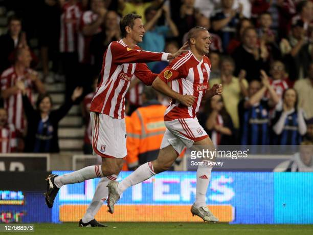 Peter Crouch of Stoke City congratulates Jonathan Walters after he scored his team's second goal during the UEFA Europa League Group E match between...