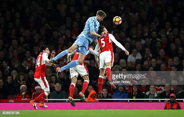 Peter Crouch of Stoke City heads towards goal during the Premier League match between Arsenal and Stoke City at the Emirates Stadium on December 10...