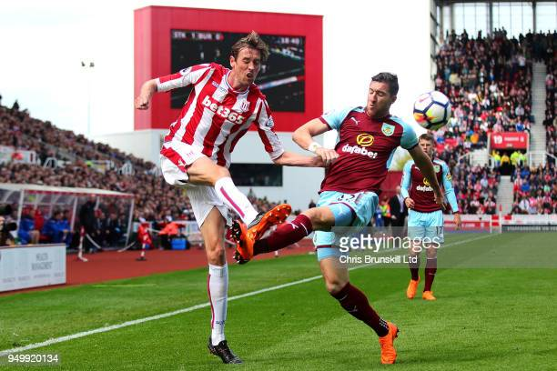 Peter Crouch of Stoke City in action with Stephen Ward of Burnley during the Premier League match between Stoke City and Burnley at Bet365 Stadium on...