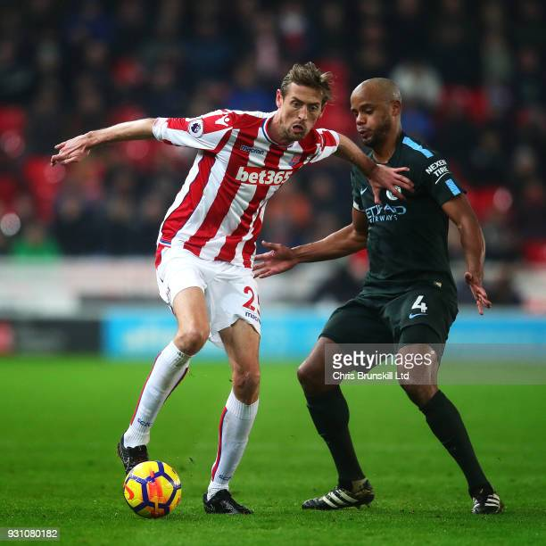Peter Crouch of Stoke City in action with Vincent Kompany of Manchester City during the Premier League match between Stoke City and Manchester City...