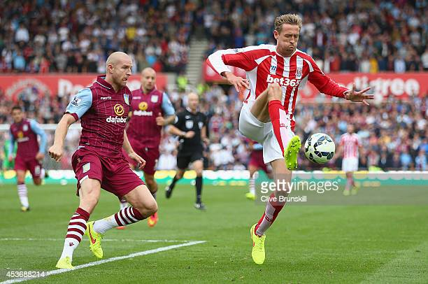 Peter Crouch of Stoke City moves away from Philippe Senderos of Aston Villa during the Barclays Premier League match between Stoke City and Aston...