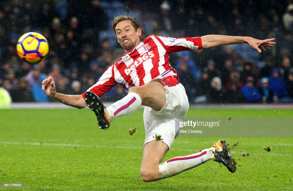 Peter Crouch of Stoke City reaches for the ball during the Premier League match between Burnley and Stoke City at Turf Moor on December 12, 2017 in Burnley, England.