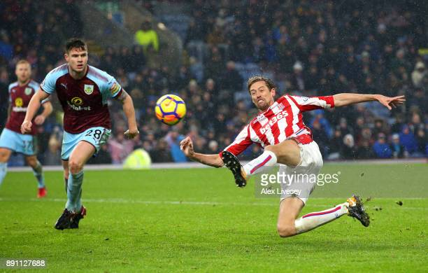Peter Crouch of Stoke City reaches for the ball during the Premier League match between Burnley and Stoke City at Turf Moor on December 12 2017 in...