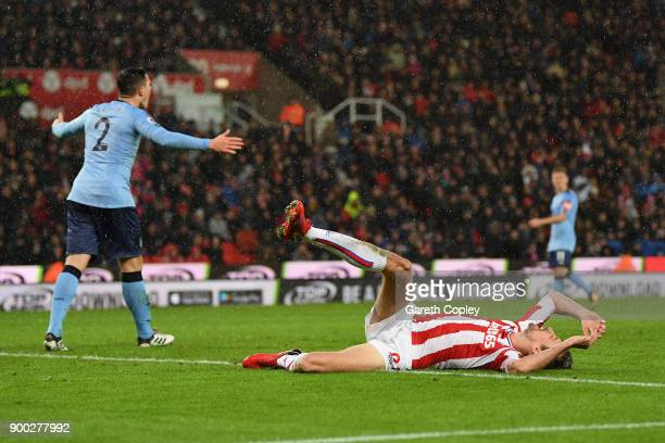 Peter Crouch of Stoke City reacts after a missed chance during the Premier League match between Stoke City and Newcastle United at Bet365 Stadium on...