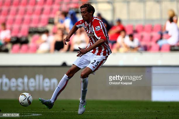 Peter Crouch of Stoke City runs with the ball during the Colonia Cup 2015 match between FC Porto and Stoke City FC at RheinEnergieStadion on August 2...