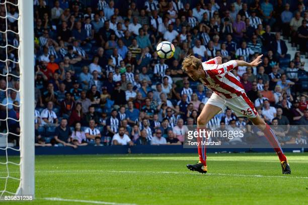 Peter Crouch of Stoke City scores his sides first goal during the Premier League match between West Bromwich Albion and Stoke City at The Hawthorns...