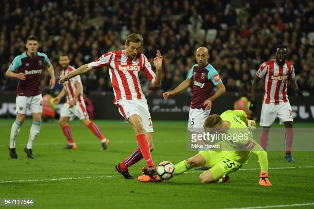 Peter Crouch of Stoke City scores his sides first goal during the Premier League match between West Ham United and Stoke City at London Stadium on...