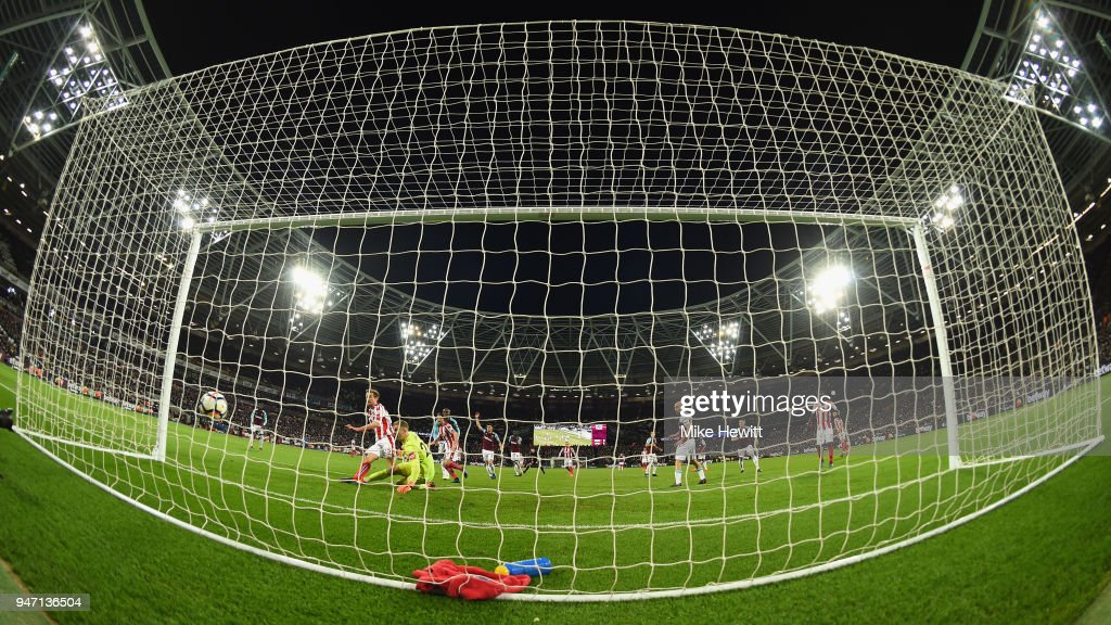 Peter Crouch of Stoke City scores his sides first goal past Joe Hart of West Ham United during the Premier League match between West Ham United and Stoke City at London Stadium on April 16, 2018 in London, England.