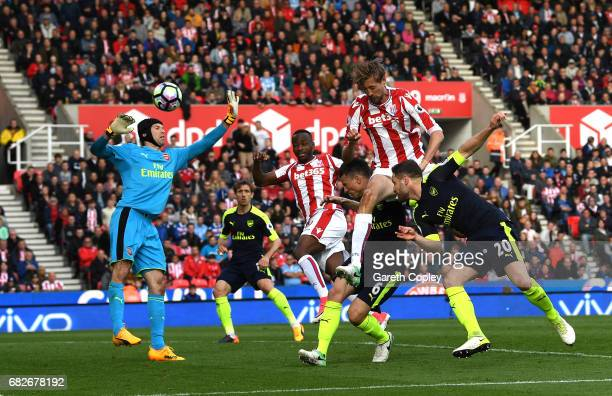 Peter Crouch of Stoke City scores his sides first goal past Petr Cech of Arsenal during the Premier League match between Stoke City and Arsenal at...