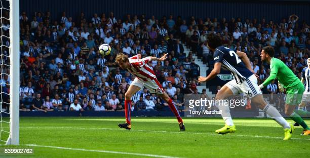 Peter Crouch of Stoke City scoring their equalising goal during the Premier League match between West Bromwich Albion and Stoke City at The Hawthorns...
