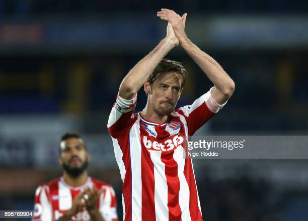Peter Crouch of Stoke City shows appreciation to the fans after the Premier League match between Huddersfield Town and Stoke City at John Smith's...