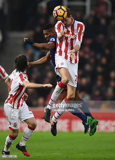Peter Crouch of Stoke City wins a header during the Premier League match between Stoke City and Manchester United at Bet365 Stadium on January 21...