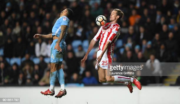 Peter Crouch of Stoke City wins a header from Jordan Willis of Coventry City during the The Emirates FA Cup Third Round match between Coventry City...