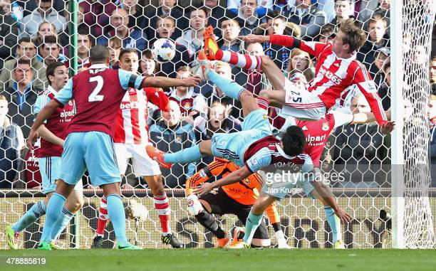 Peter Crouch of Stoke City's shot deflects in to the goal off of Peter Odemwingie of Stoke City for their first as James Tomkins of West Ham United...