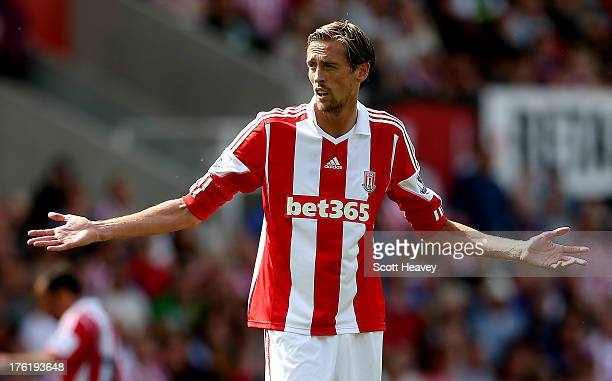 Peter Crouch of Stoke during a Pre Season Friendly between Stoke City and Genoa at Britannia Stadium on August 10 2013 in Stoke England