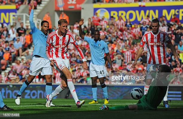 Peter Crouch of Stoke scores to make it 1-0 during the Barclays Premier League match between Stoke City and Manchester City at the Britannia Stadium...