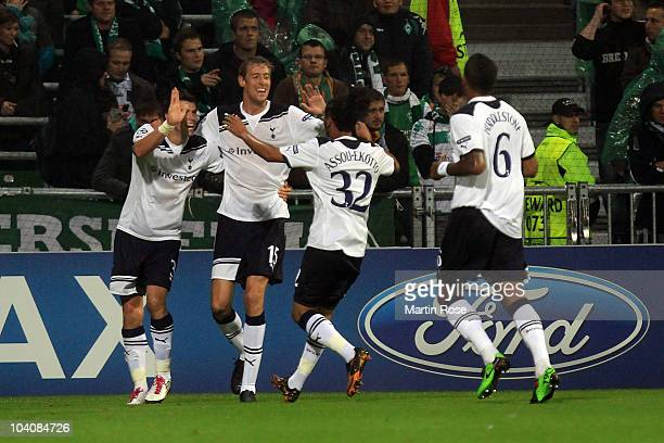 Peter Crouch of Tottenham celebrates with his team mates after he scores his team's opening goal during the UEFA Champions League group A match...
