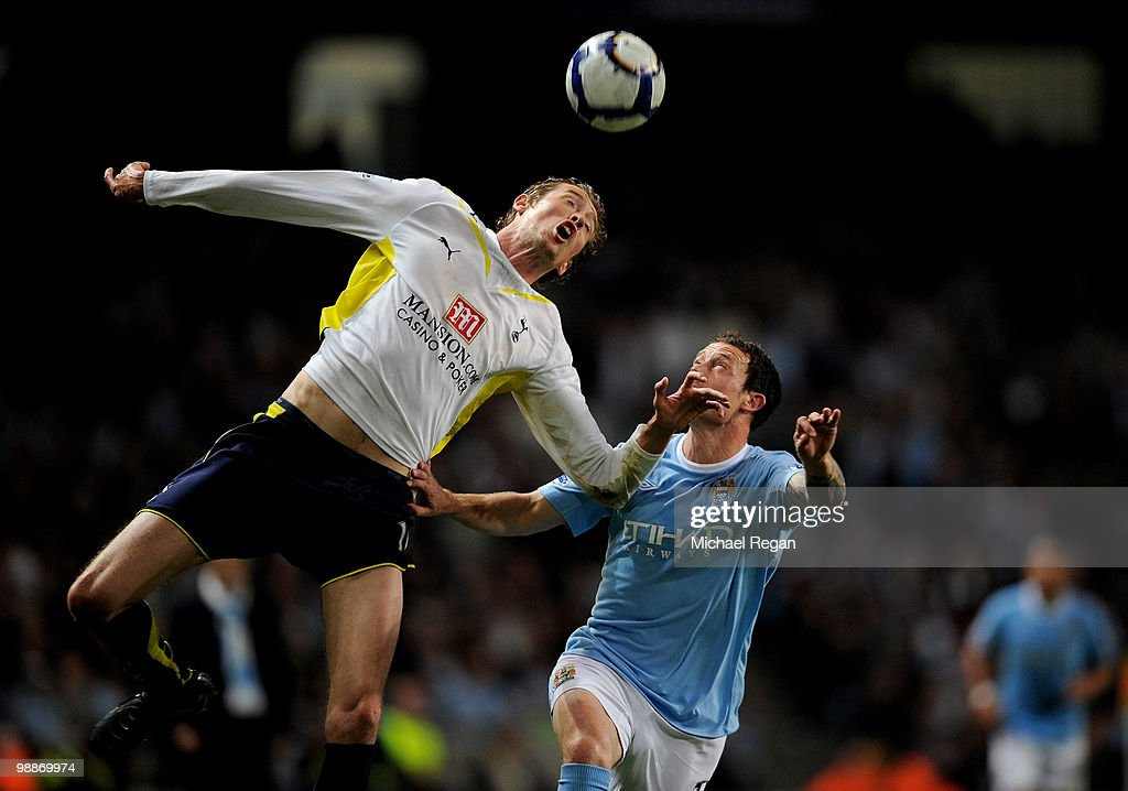 Peter Crouch of Tottenham Hotspur beats Wayne Bridge of Manchester City to the ball during the Barclays Premier League match between Manchester City and Tottenham Hotspur at the City of Manchester Stadium on May 5, 2010 in Manchester, England.