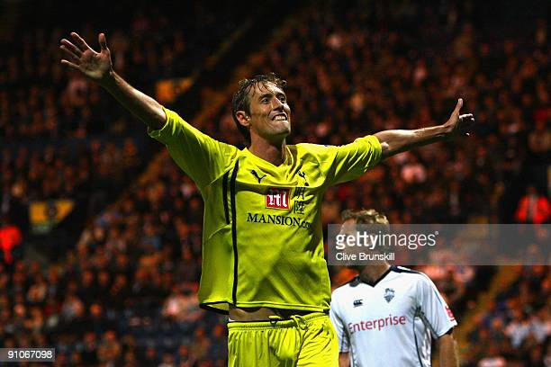 Peter Crouch of Tottenham Hotspur celebrates scoring his team's third goal during the Carling Cup Third round match between Preston North End and...