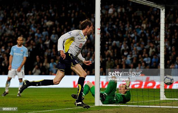 Peter Crouch of Tottenham Hotspur celebrates scoring the opening goal during the Barclays Premier League match between Manchester City and Tottenham...