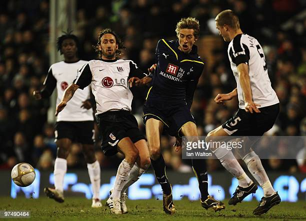 Peter Crouch of Tottenham Hotspur holds off the challenge of Jonathan Greening and Brede Hangeland of Fulham during the FA Cup sponsored by EON...