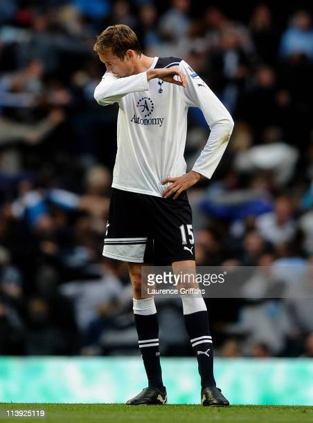 Peter Crouch of Tottenham Hotspur looks dejected after scoring an own goal during the Barclays Premier League match between Manchester City and...