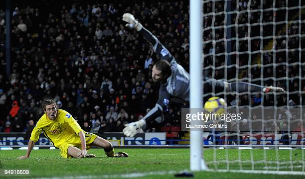 Peter Crouch of Tottenham Hotspur scores past Paul Robinson but the goal was dissallowed during the Barclays Premier League Match between Blackburn...