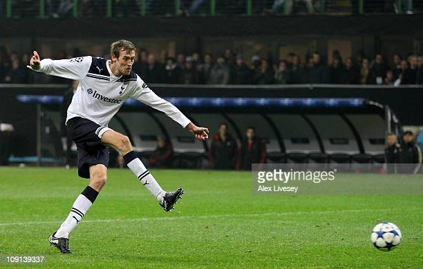 Peter Crouch of Tottenham Hotspur scores the opening goal during the UEFA Champions League round of 16 first leg match between AC Milan and Tottenham...