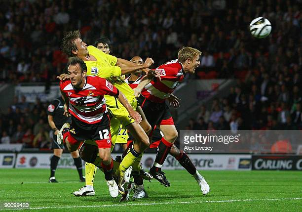 Peter Crouch of Tottenham Hotspur scores the third goal during the Carling Cup second round match between Doncaster Rovers and Tottenham Hotspur at...