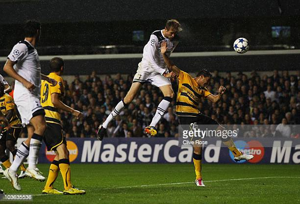 Peter Crouch of Tottenham Hotspur scores their third goal during the UEFA Champions League play-off second leg match between Tottenham Hotspur and...