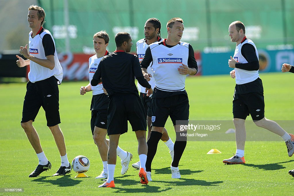 Peter Crouch, Stephen Warnock, Glen Johnson, John Terry and Wayne Rooney warm up during the England training session at the Royal Bafokeng Sports Campus on June 5, 2010 in Rustenburg, South Africa.