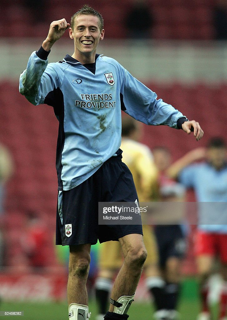 Peter Crouch the Southampton striker who scored two goals celebrates with the travelling fans after his side's 3-1 victory in the Barclays Premiership match between Middlesbrough and Southampton at the Riverside Stadium on March 20, 2005 in Middlesbrough, England