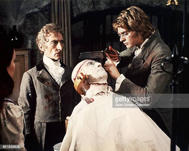 Peter Cushing as Baron Frankenstein and Simon Ward as Dr Karl Holst in 'Frankenstein Must Be Destroyed' 1969
