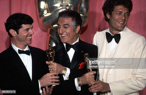 Peter Davis with Bert Schneider pose backstage with actor Danny Thomas after winning Best Documentary award during the 47th Academy Awards at Dorothy...
