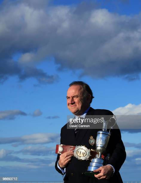 Peter Dawson the Chief Executive of the R&A holds the Open Championship Trophy and the original Champion Belt awarded to the early winners of the...