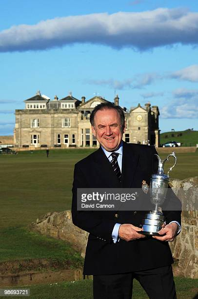 Peter Dawson the Chief Executive of the R&A holds the Open Championship Trophy as a preview for the 2010 Open Championship to be held on the Old...