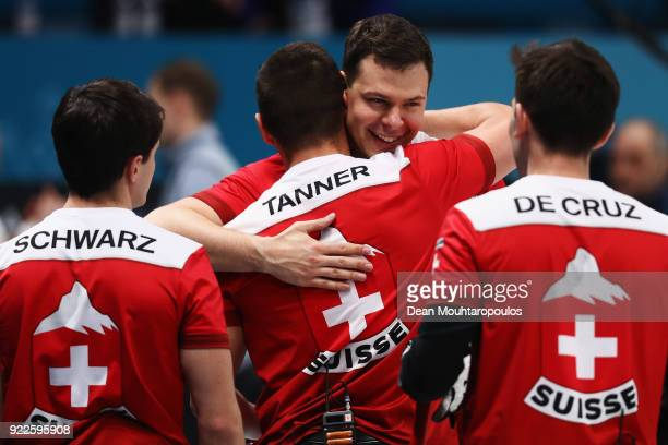 Peter de Cruz, Valentin Tanner, Claudio Patz and Benoit Schwarz of Switzerland celebrate victory after the Curling Men's Tie-breaker against Great...