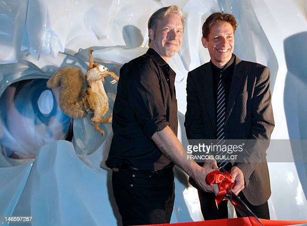 Peter de Seve US character designer of the US animation films 'Ice Age' and Mike Defeo US 3D character designing sculptor pose in front of the effigy...