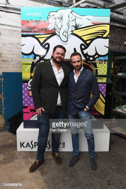 Peter De Vries of Virgin Racing and Andrea Ferrero of Kaspersky Lab attend the unveiling of the firstever Formula art car by Kaspersky Lab and street...