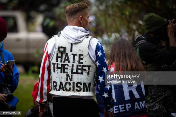 Peter Diaz, founder of American Wolf, is among the several hundred people, members of the Proud Boys and other similar groups gathered for a rally at...