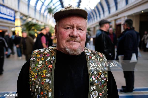 Peter Dickinson from Pontefract poses for a photograph as he attends on the first day of the annual British Homing Pigeon World Show of the Year at...