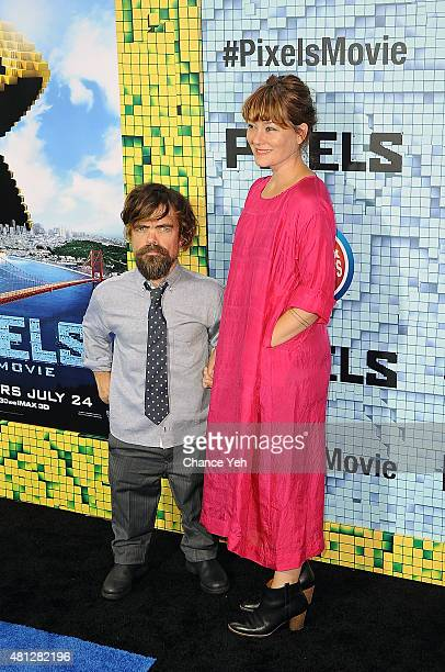 Peter Dinklage and Erica Schmidt attend Pixels New York premiere at Regal EWalk on July 18 2015 in New York City