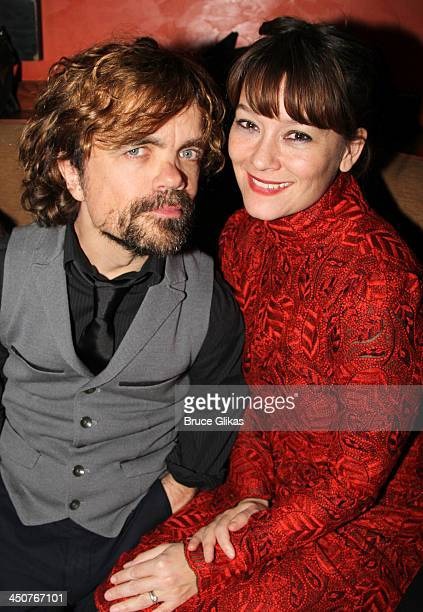 Peter Dinklage and wife director Erica Schmidt pose at the opening night party for Taking Care of Baby at Faces Names Lounge on November 19 2013 in...