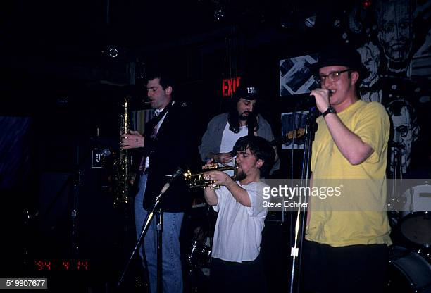 Peter Dinklage performs playing trumpet with Whizzy at Columbia University, New York, New York, July 1, 1994.
