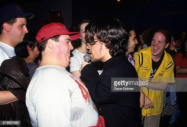 Peter Dinklage performs singing with Whizzy at Columbia University, New York, New York, 1994.