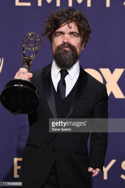 Peter Dinklage, winner of the Outstanding Supporting Actor in a Drama Series award for 'Game of Thrones,' poses in the press room during the 71st...