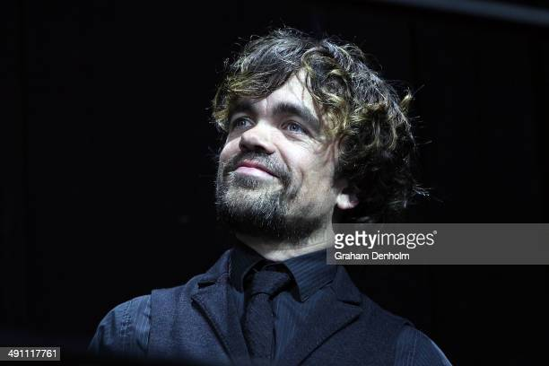 """Peter Dinklages poses as he arrives at the Australian premiere of 'X-Men: Days of Future Past"""" on May 16, 2014 in Melbourne, Australia."""